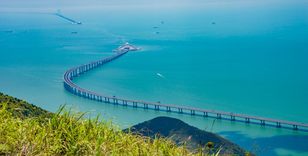 The Hong Kong–Zhuhai–Macau Bridge stretches into a tunnel underneath the bay