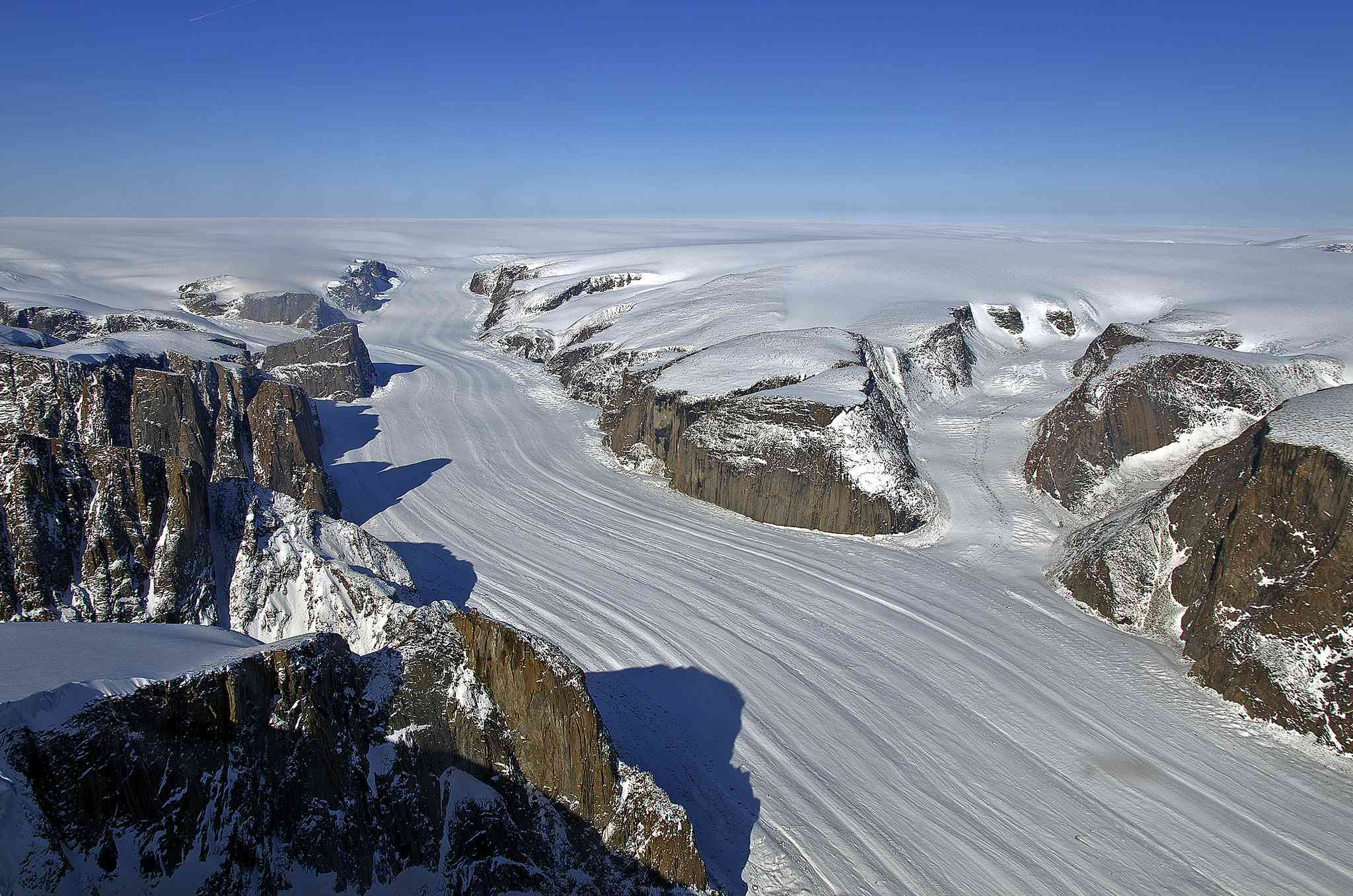 An outlet glacier flows from the Penny Ice Cap on Baffin Island, Nunavut, Canada