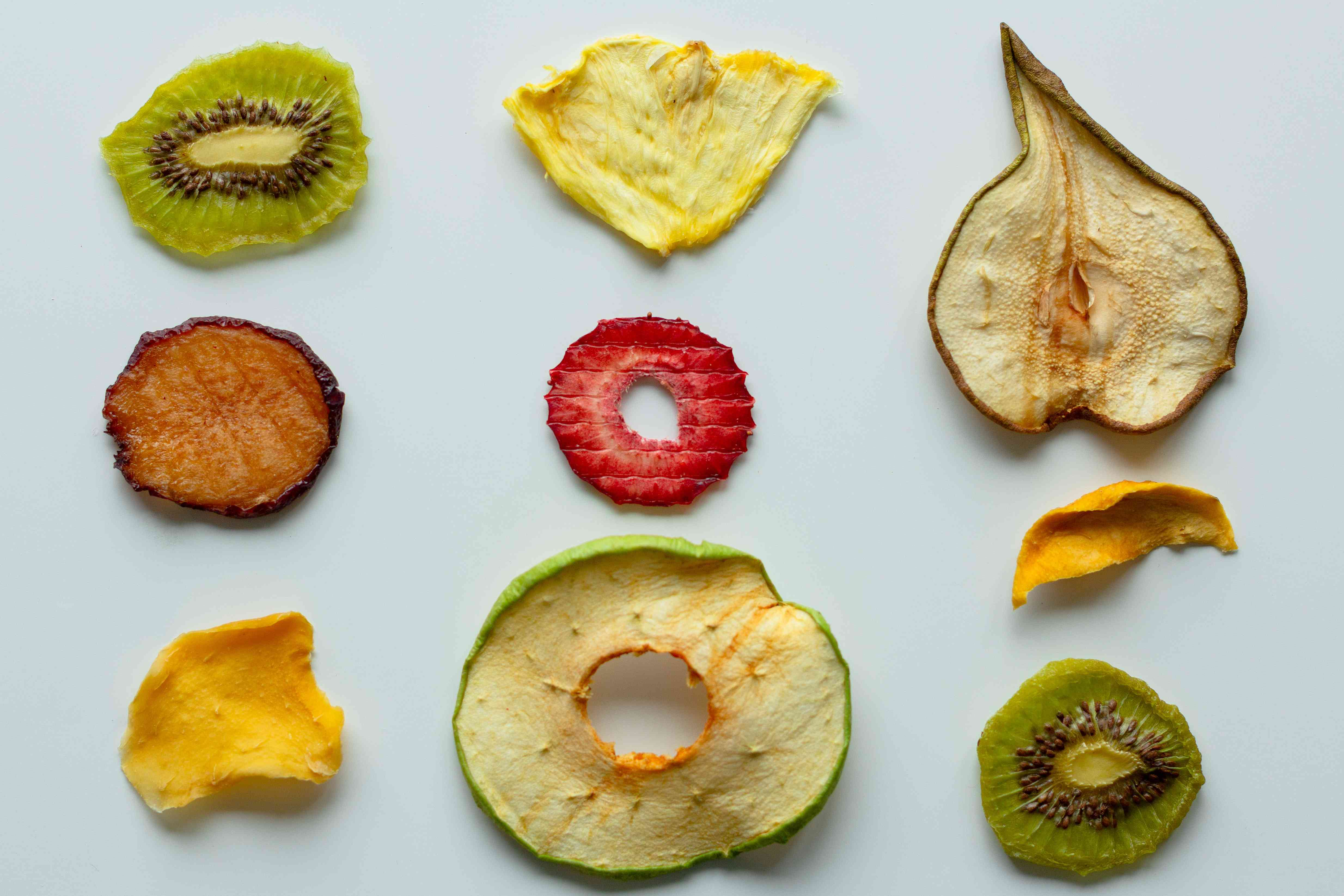 Slices of dried fruit laid out on white surface