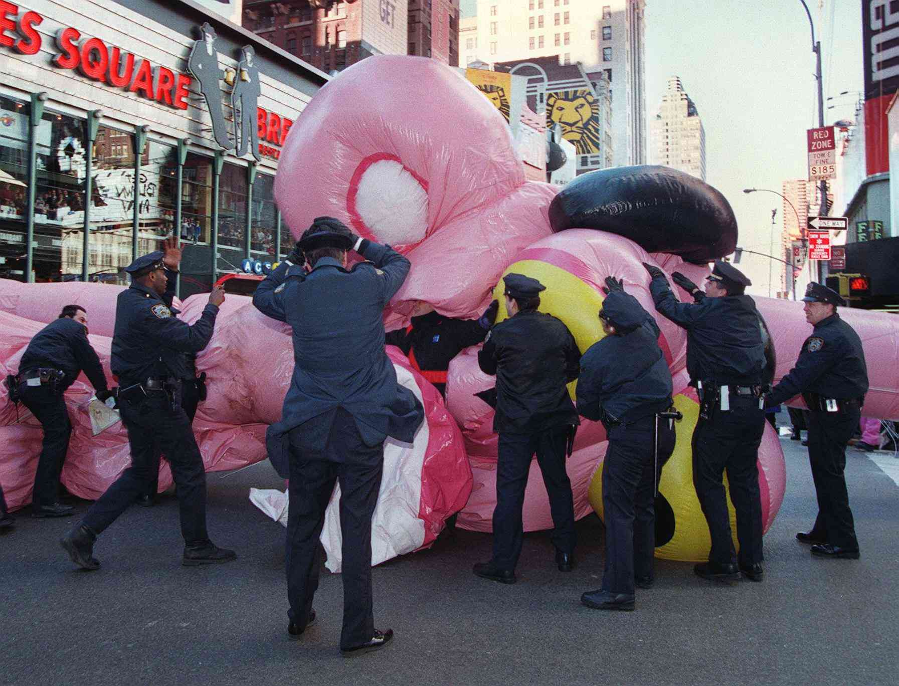 police rescuing Pink Panther balloon at Macy's parade