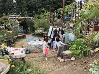 Painting in the garden at Arts and Roots Garden