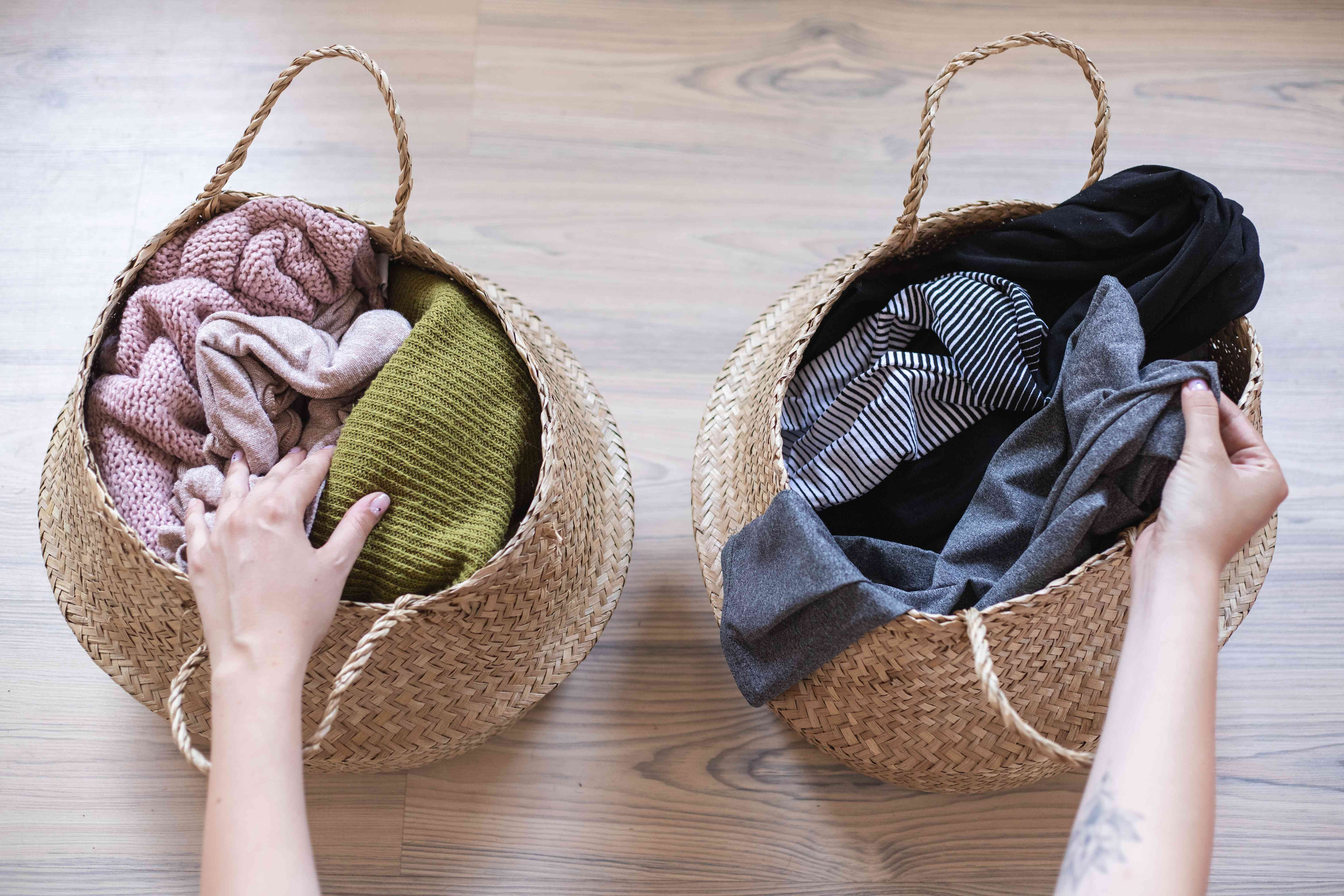 separate woven basket laundry hampers holding knitwear and workout wear
