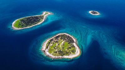 Fish shaped Gaz Island and two smaller islands in Brijuni National Park