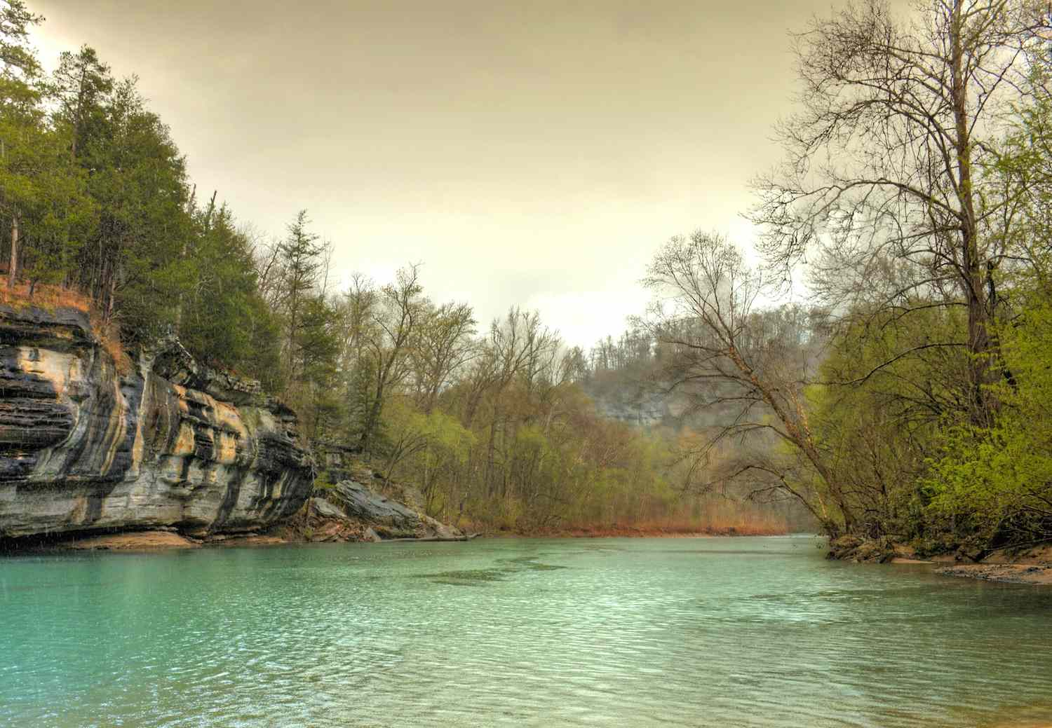 Turquoise water of the Buffalo National River on a cloudy day