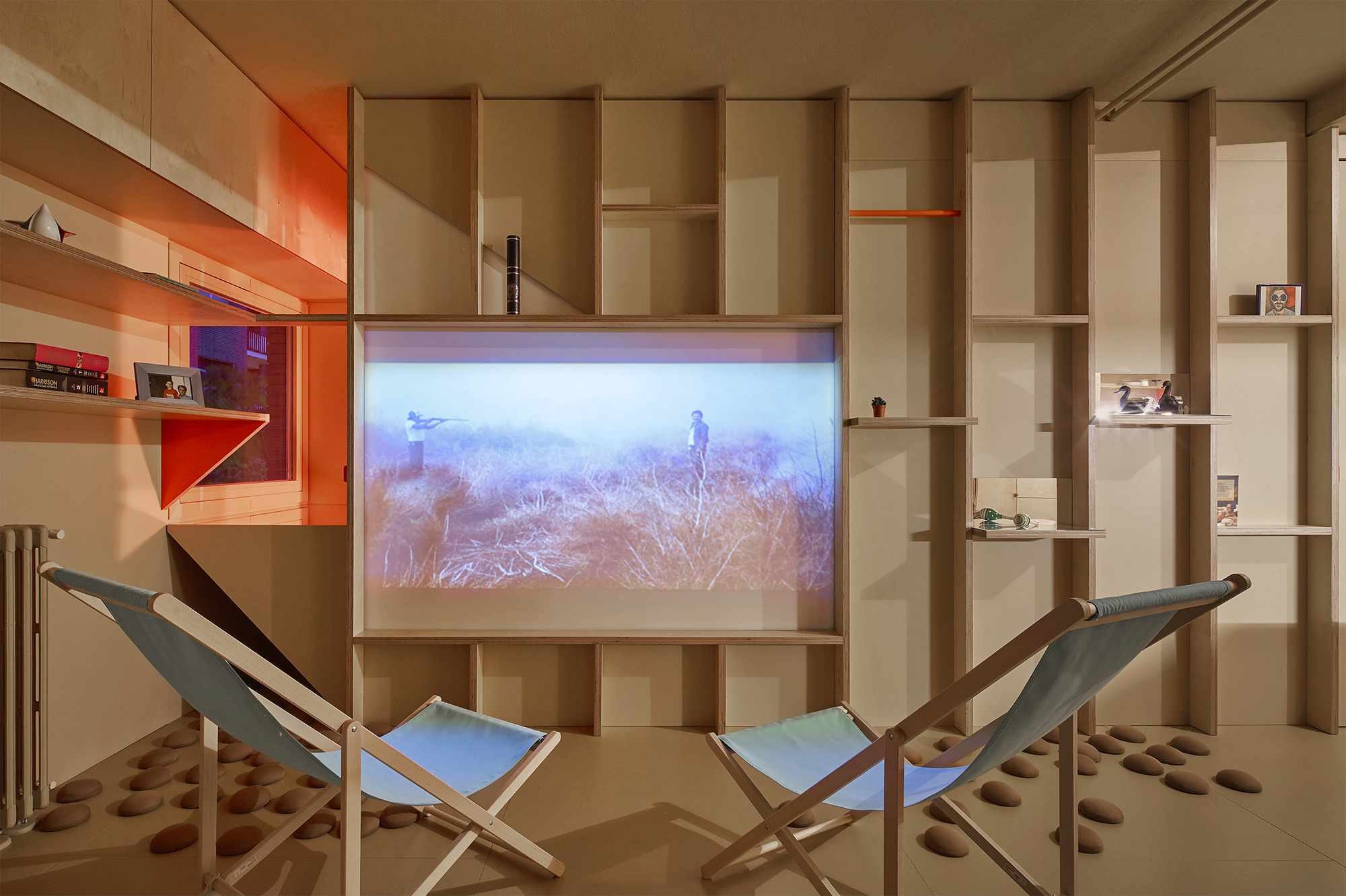 small apartment renovation madrid Husos Architects sliding door as projection screen