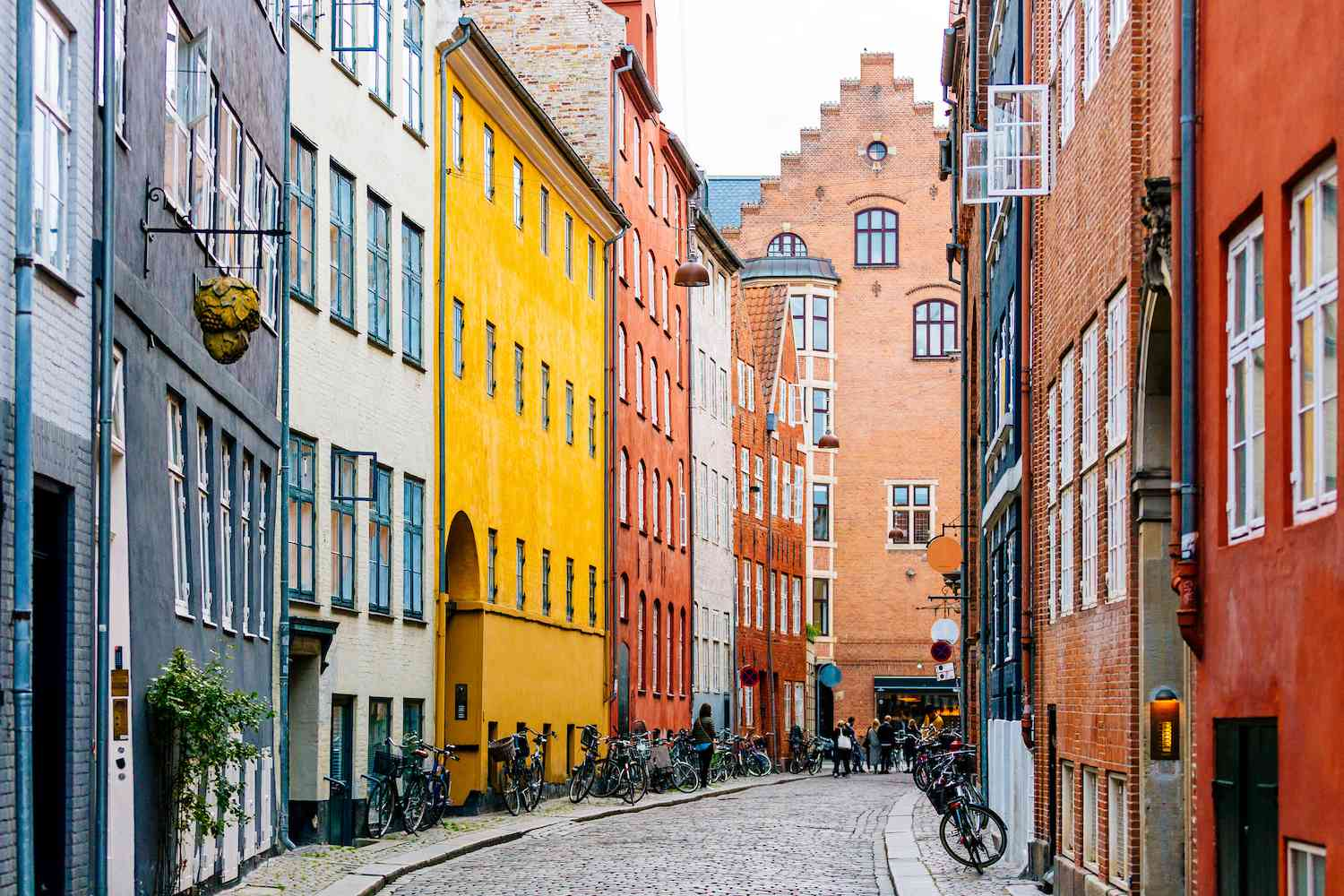Colorful buildings on a cobbled road lined with bicycles