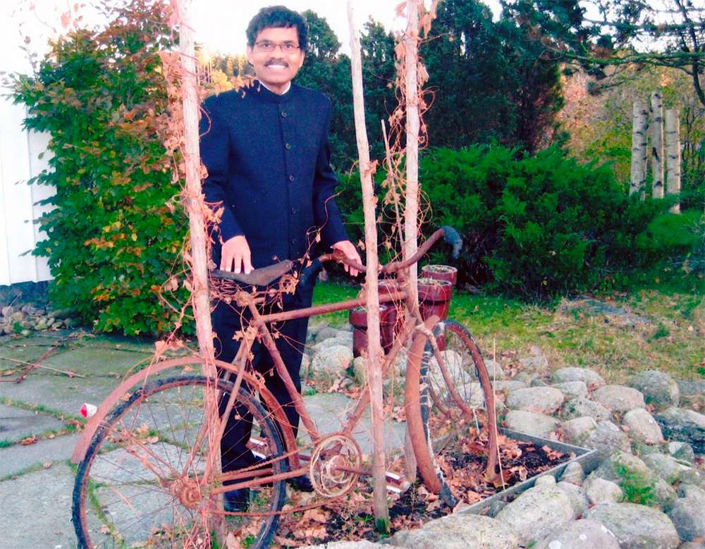 PK Mahanandia with one of the bikes he used to cover the more than 2,000 miles from India to Sweden along the 'Hippie Trail.'