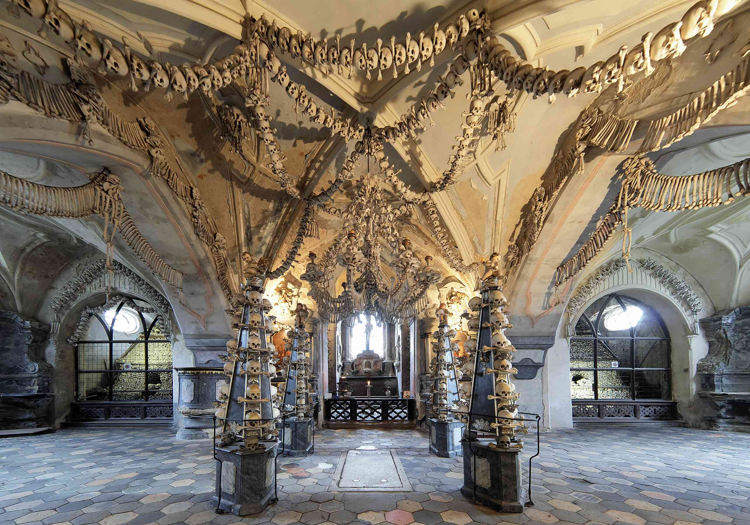 Bones and skulls elaborately decorate the ceiling of Sedlec Ossuary in the Czech Republic