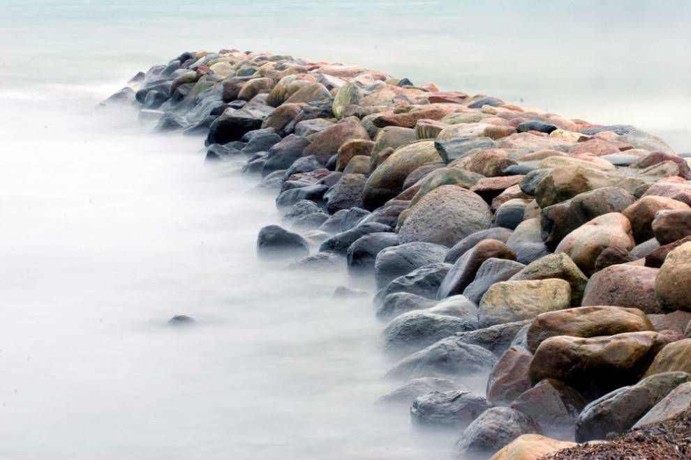 Water washes up against rocks in Denmark