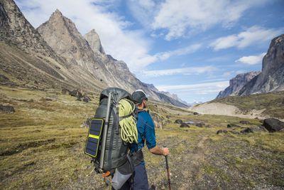 Man hiking with solar panel