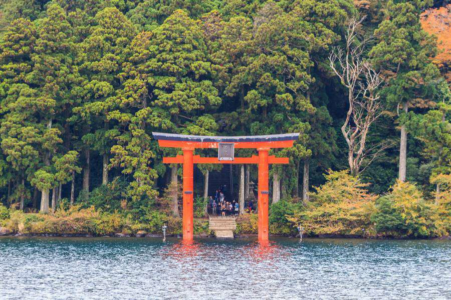 Torii gate on the shore of Lake Ashi near Mount Fuji