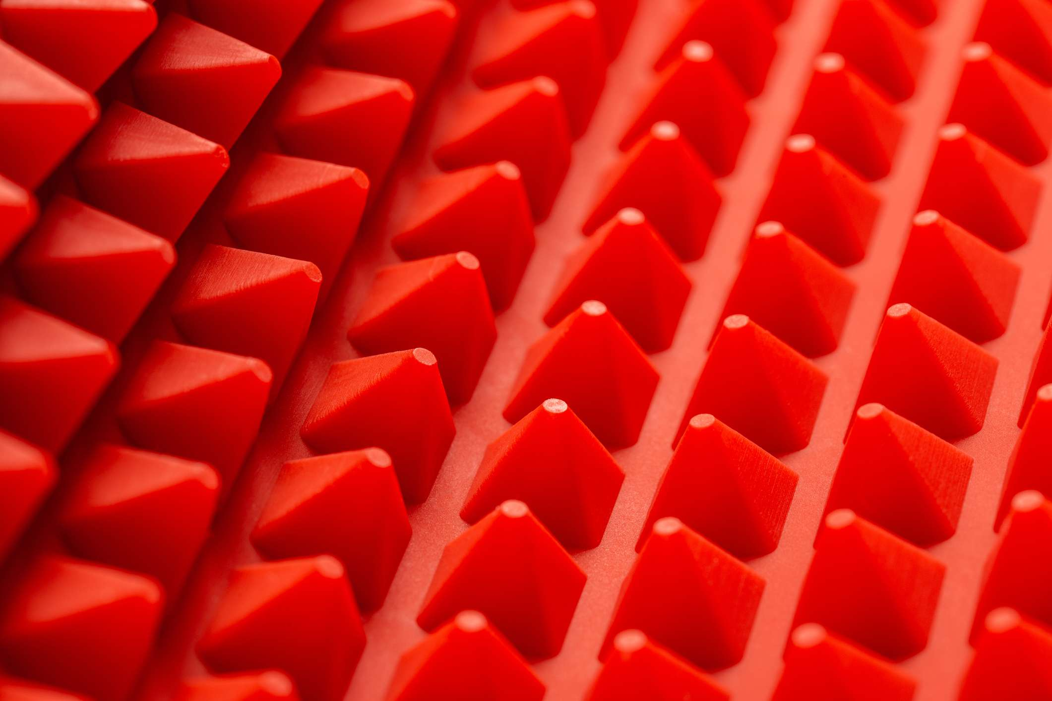 abstract red silicone pyramids mat close-up background