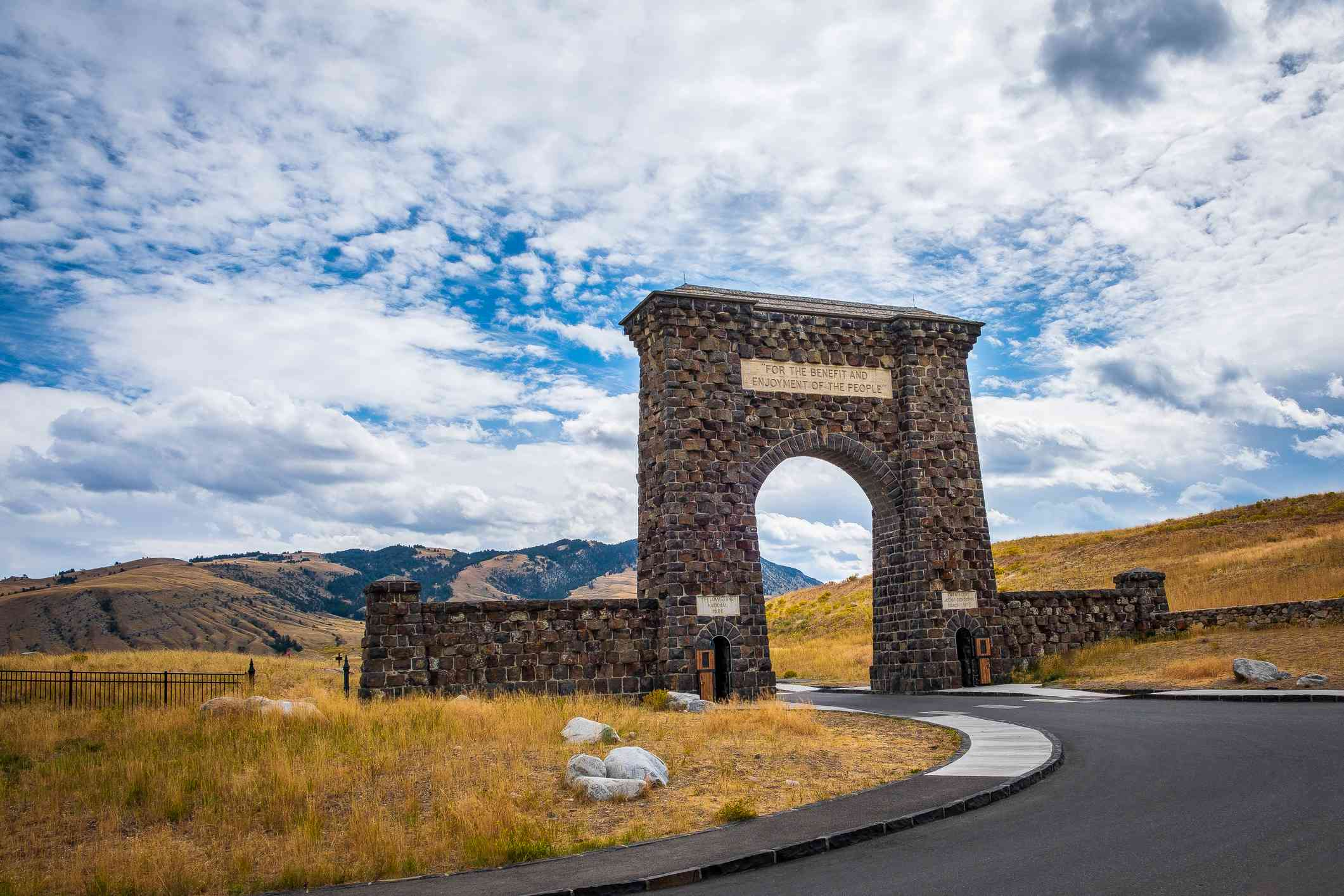 View of Roosevelt Arch with hills in the background