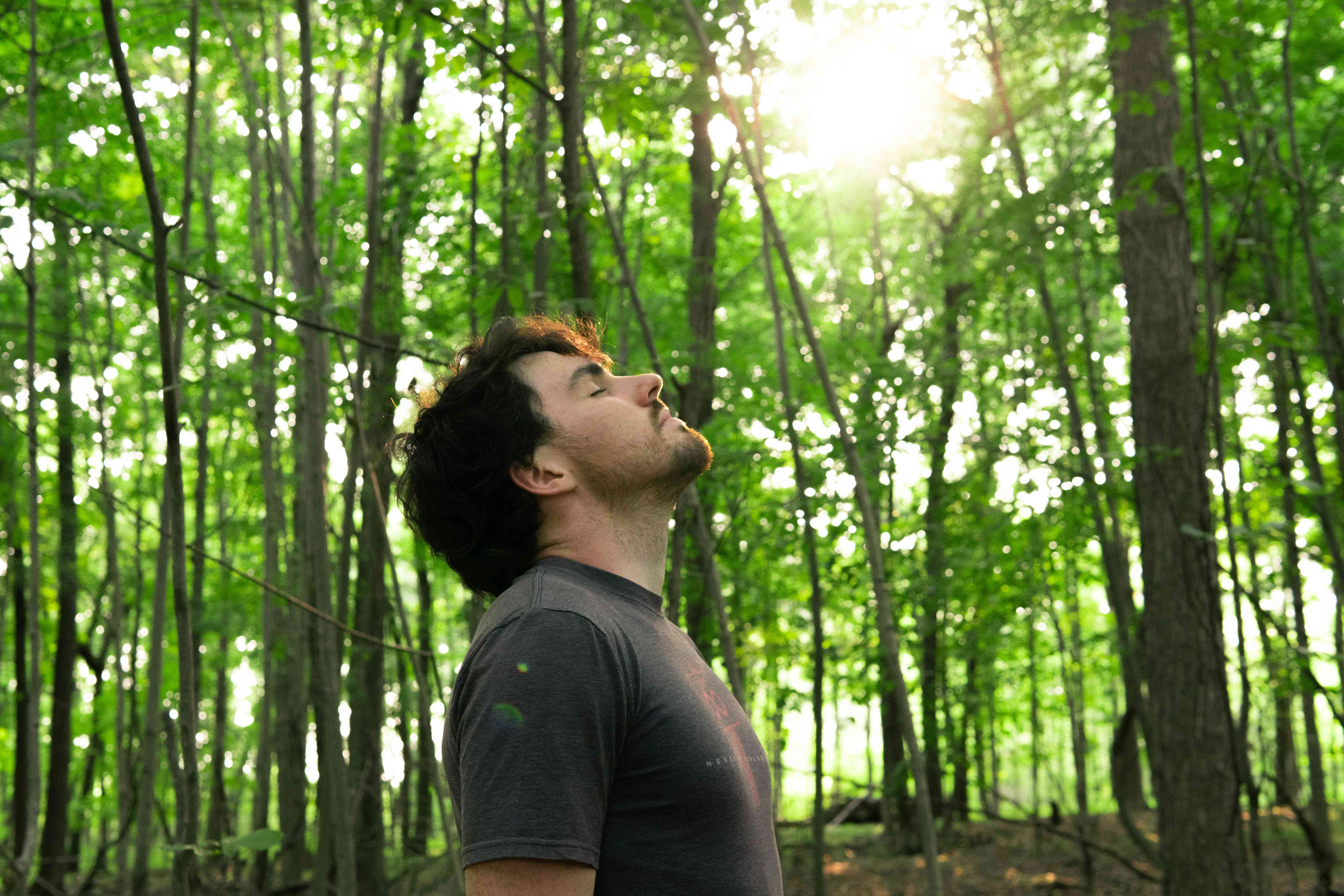 guy breathes in forest background