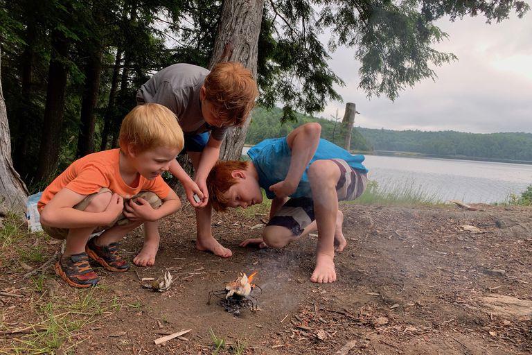 boys lighting a fire