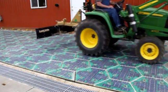 Tractor on solar roadway panel