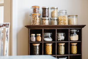 various glass jars filled with dried goods