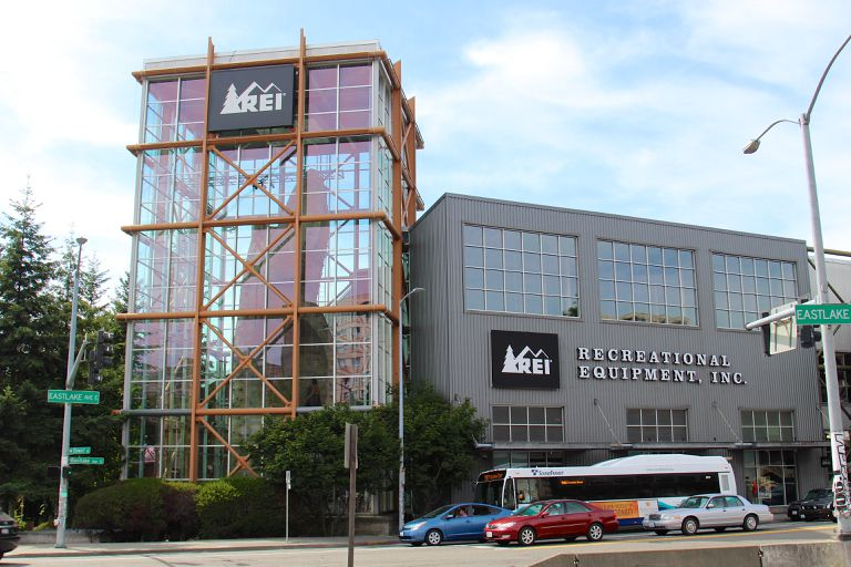 The outside of a REI store with large glass windows.