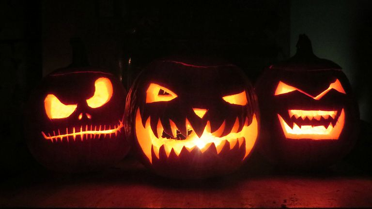 A row of three jack-o-lanterns