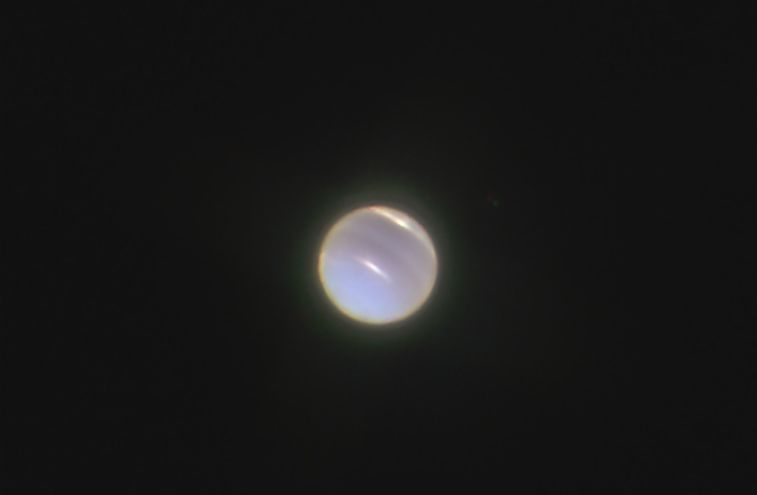 Neptune as seen through a telescope and magnified 200%.