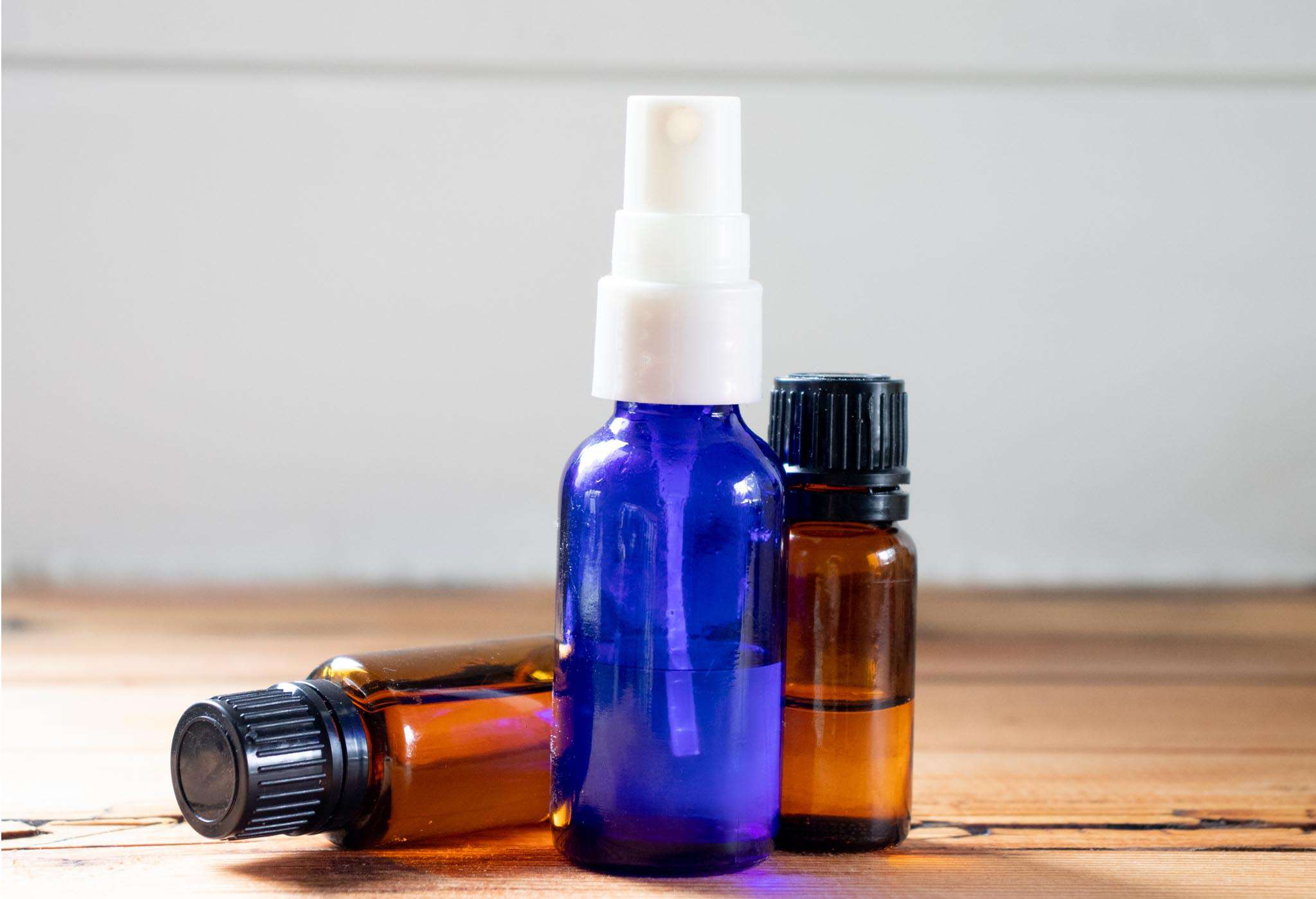 essential oils and rubbing alcohol in refillable bottles