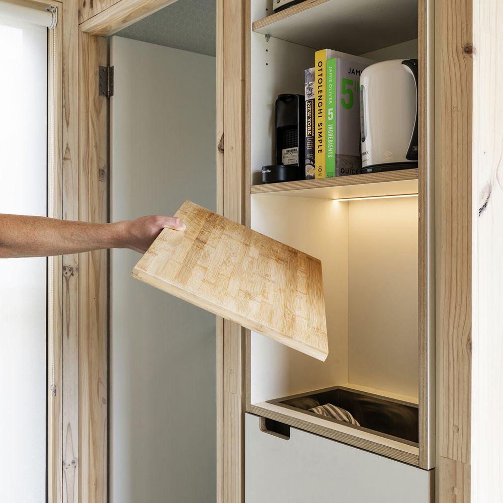 Hidden storage under a removable countertop
