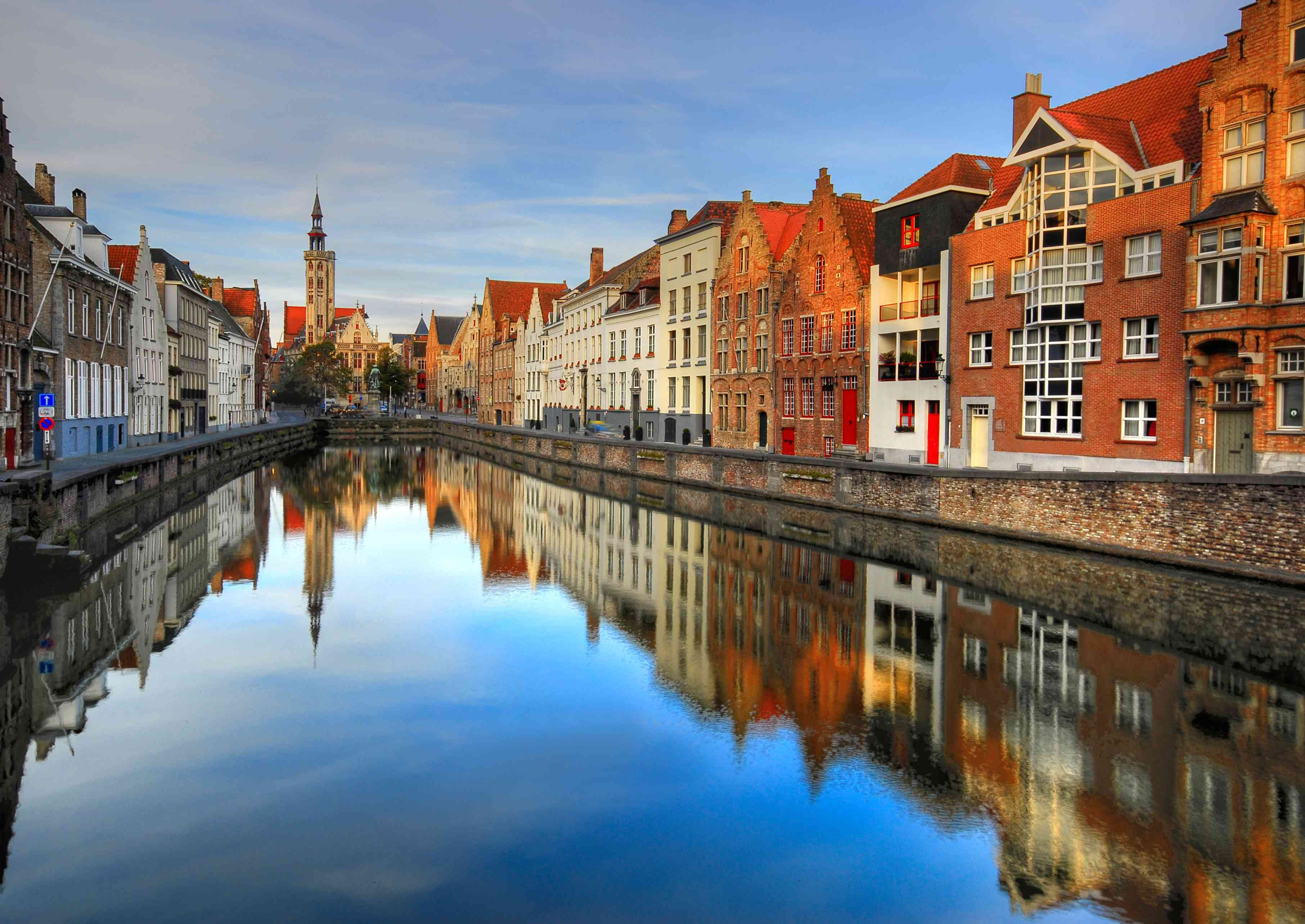 Water town in Bruges with homes on both sides of a narrow waterway