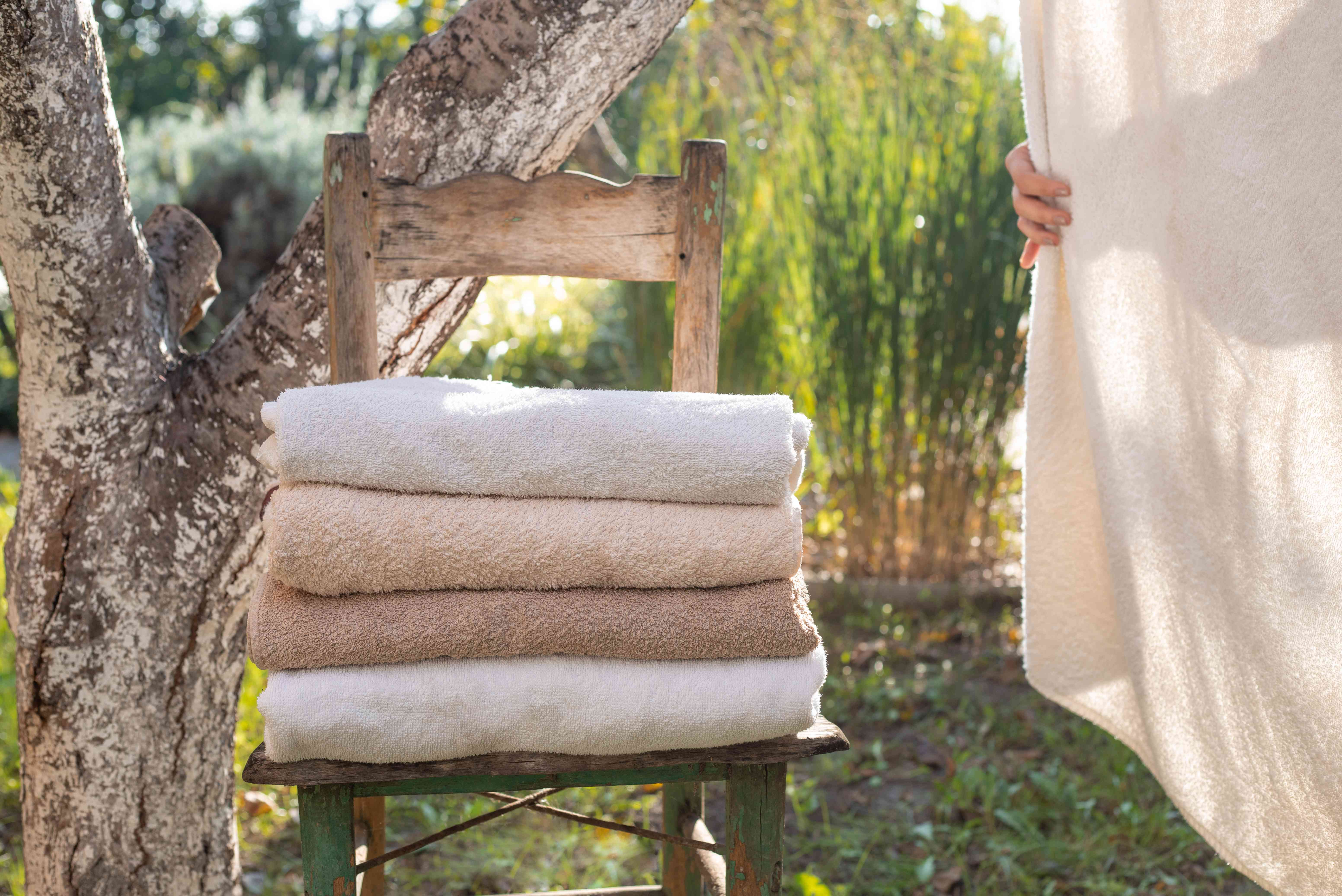 stack of towels on chair outside