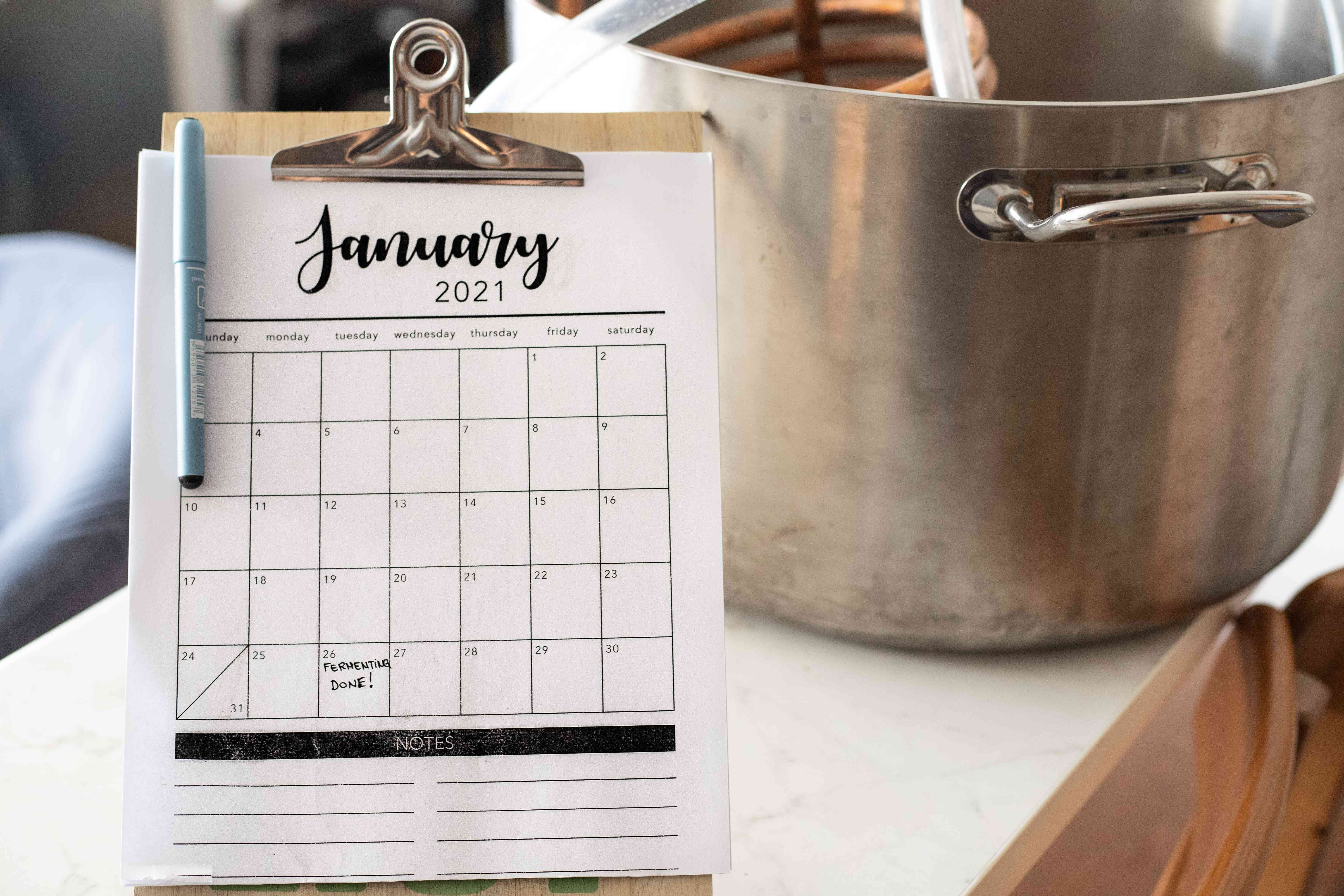 calendar with large cooking pot showing the fermentation schedule