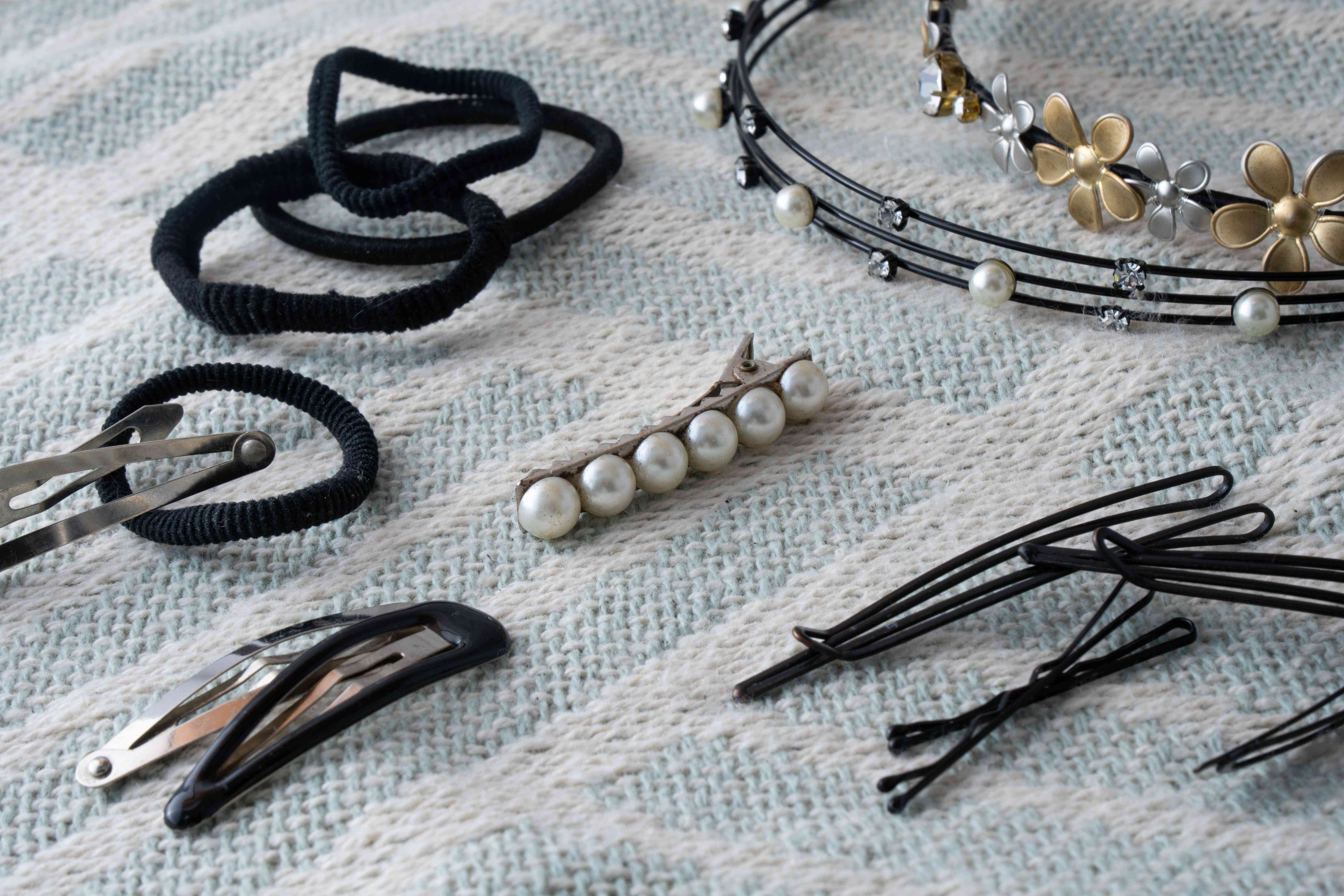 various hair accessories rubber bands clips and headbands on fabric