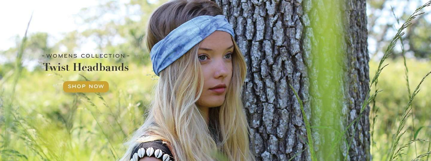 Woman wearing a headband standing next to a tree