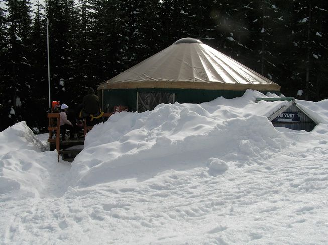A yurt surrounded by snow