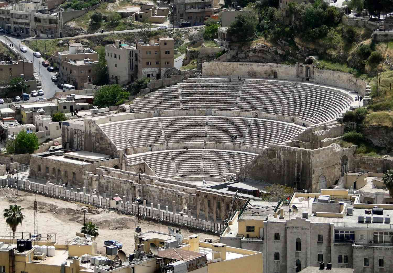 The Roman Theater in Amman, Jordan surrounded by modern streets and buildings