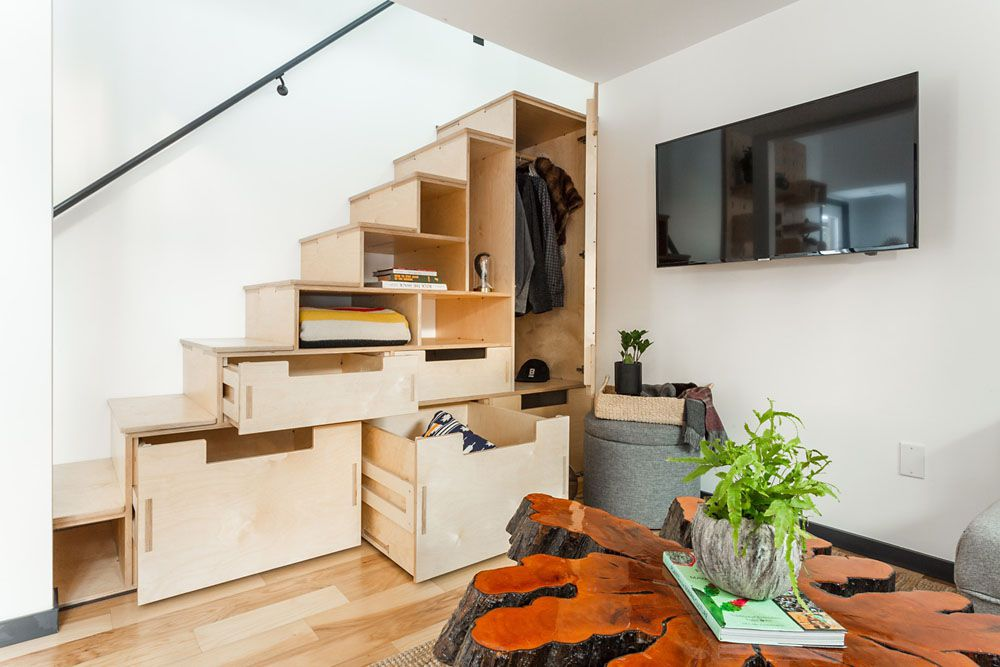 Stair storage in the tiny home with drawers and doors open