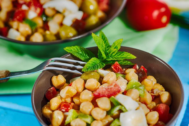 A cold chickpea salad with other vegetables