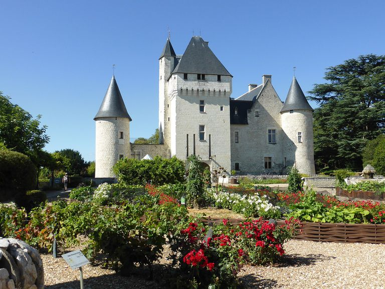 Fairy-tale-like Château du Rivau with flower gardens in foreground