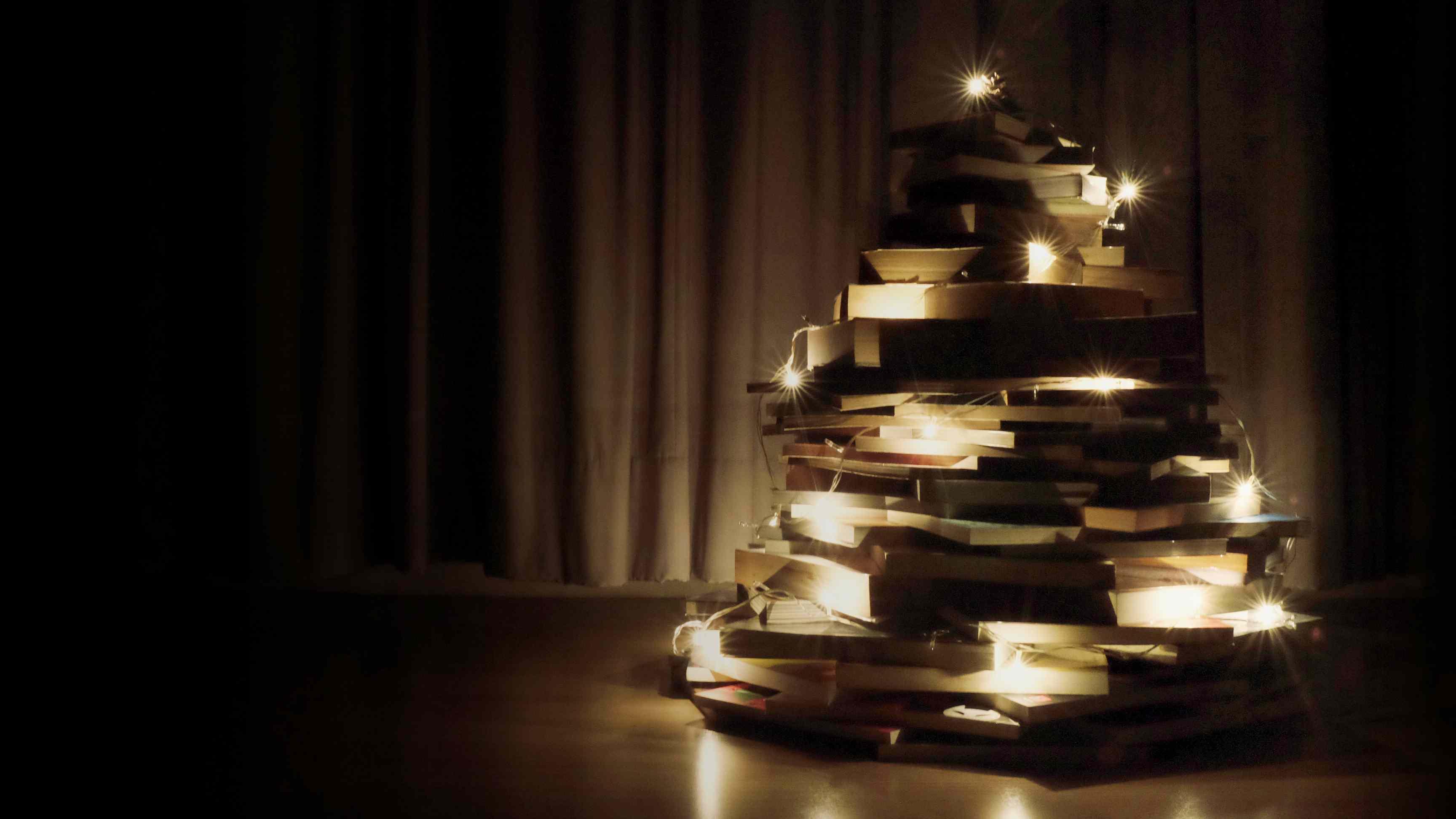 small Christmas tree made of books and lights