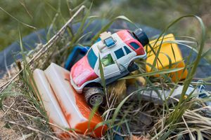 Old broken toys in the grass