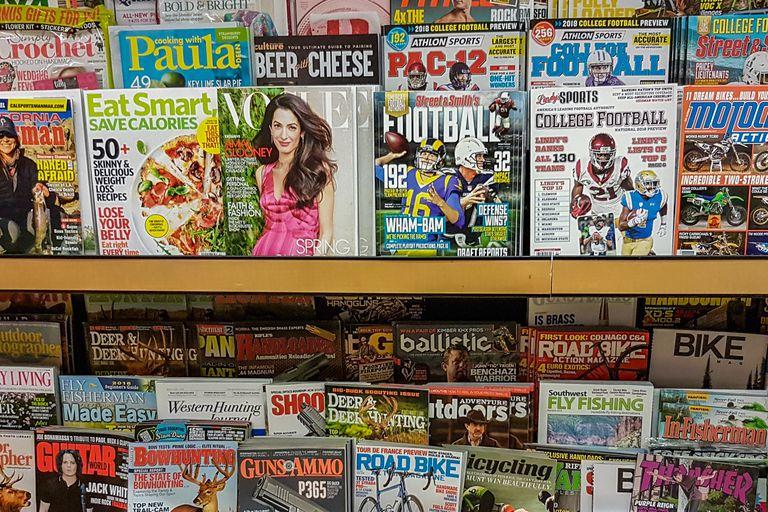 Magazines organized on store shelves
