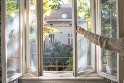 arm opens window with sunshine