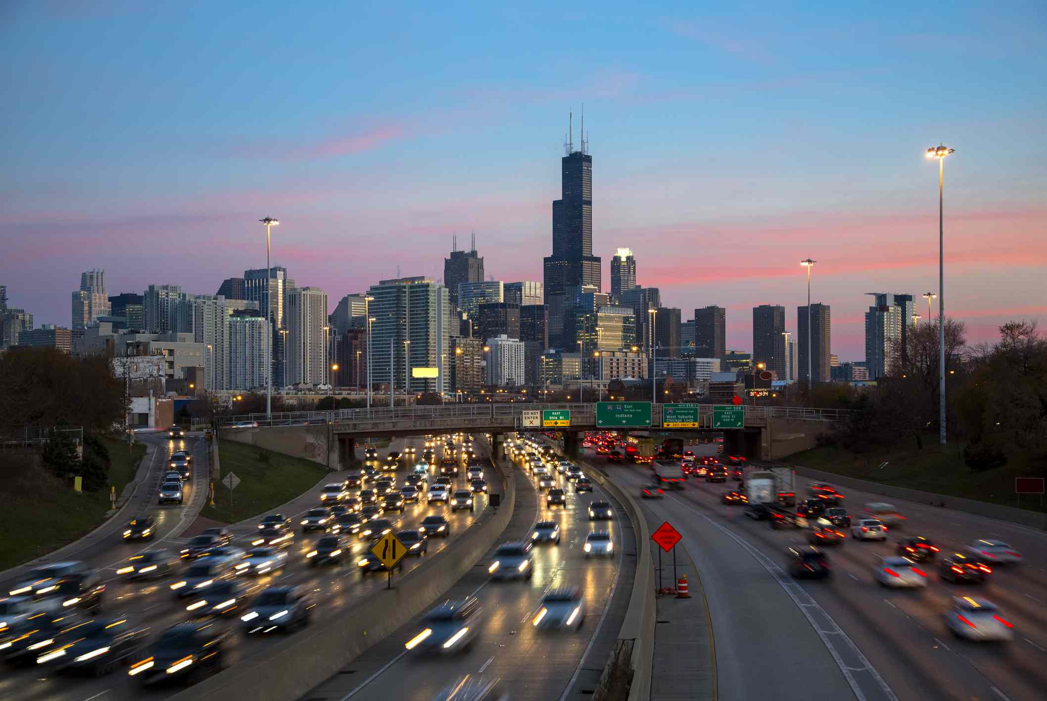 Aerial view of Chicago highway traffic at dusk