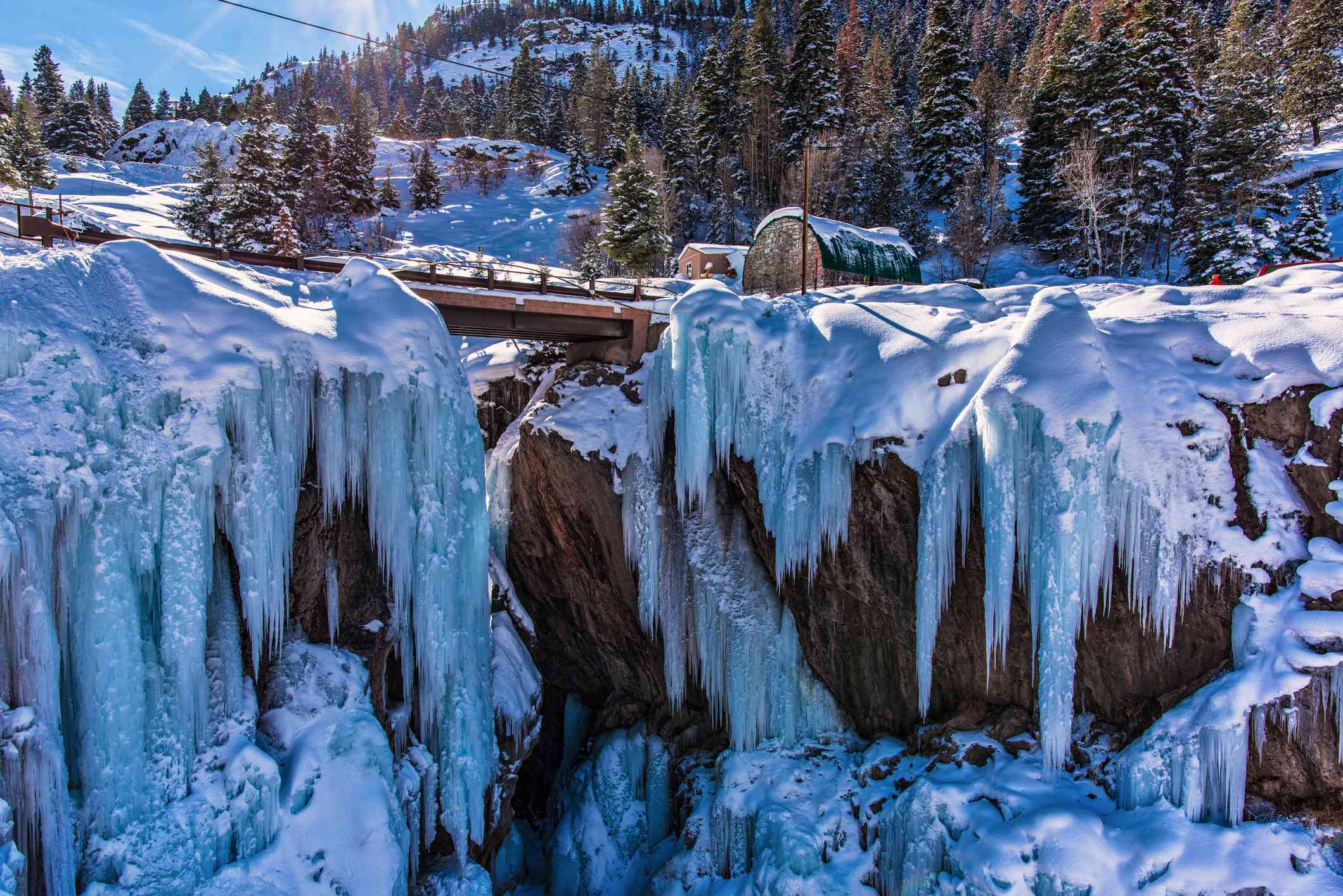 Footbridge between two ice-covered cliffs in Ouray