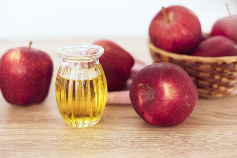 Close up red Apple fruit and apple cider vinegar juice , Helps Lose Weight and Reduces Belly Fat , healthy food