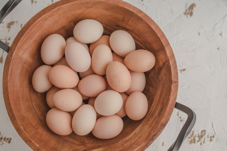 fresh eggs sitting in a bowl