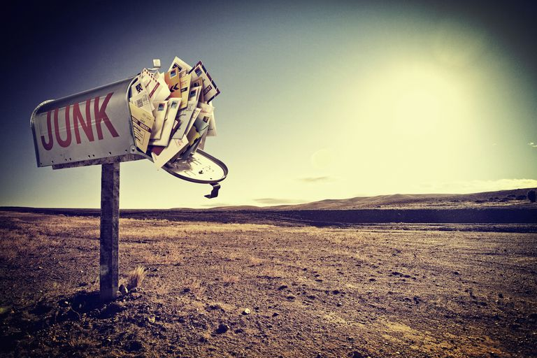 """mailbox in the desert labeled with the word """"junk"""" and stuffed with mail"""