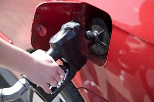 Close-up of a person pumping gas