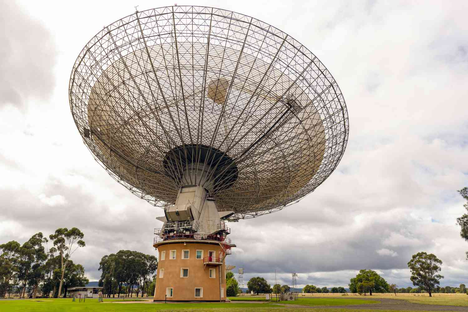 The second largest radio telescope in the Southern Hemisphere sits atop the circular Parkes Observatory on a cloudy day