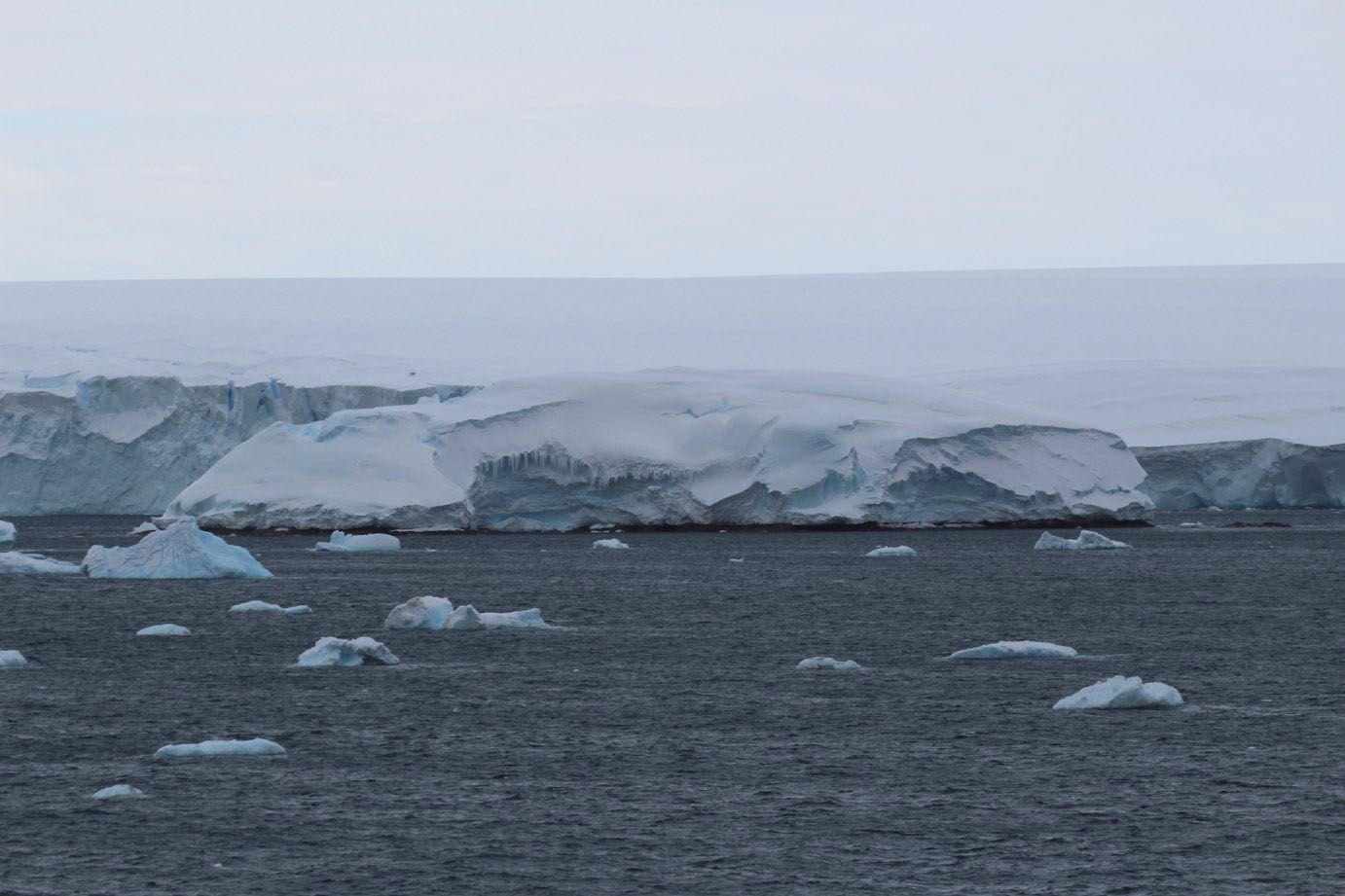 long view of a bleak and icy Sif Island, a new island formed in Antarctica