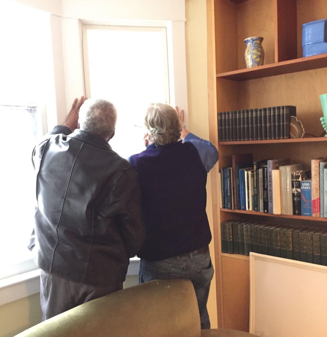 Two men installing Indow panel