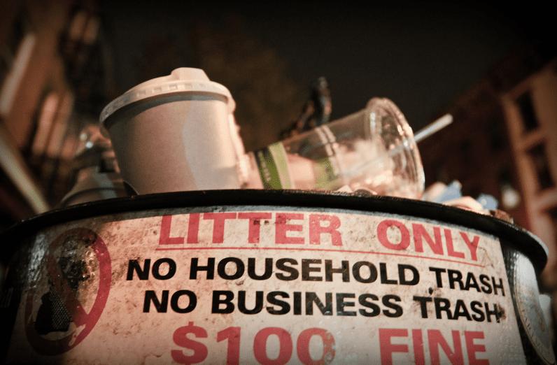 overflowing public trash bin in NYC
